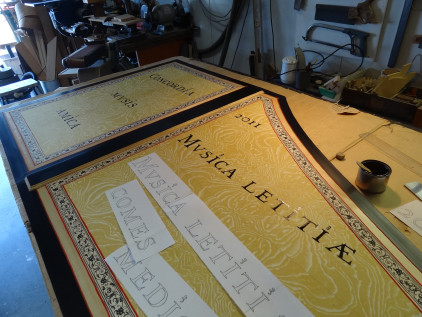 Royal Opera House, Muscat: Flemish harpsichord Latin motto in progress 57K jpeg