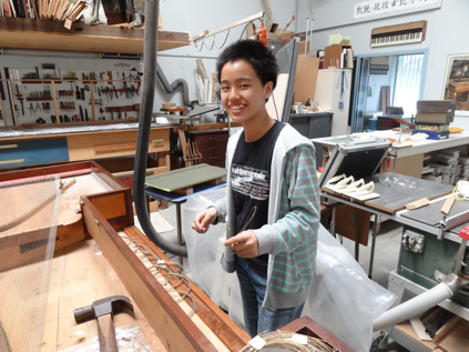 Lisa in the harpsichord workshop 59K jpeg